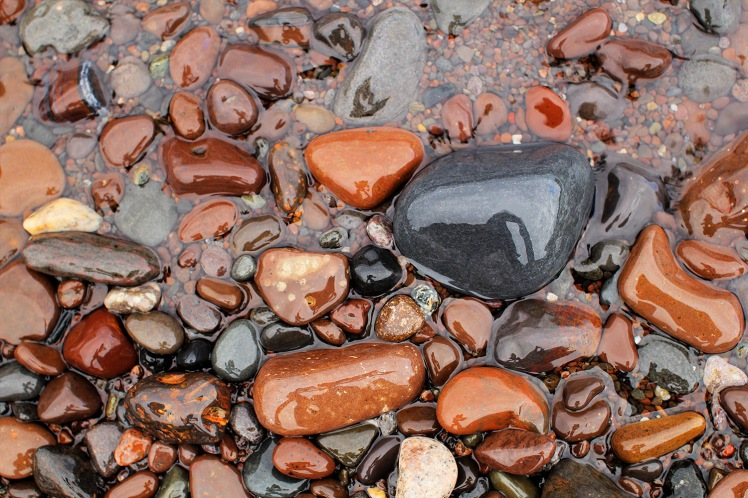 Lake Superior Shoreline with close up of colorful wet shiny rock